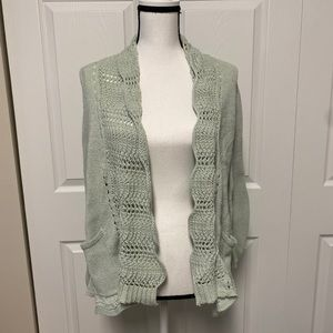 Angel of the North, small light green cardigan